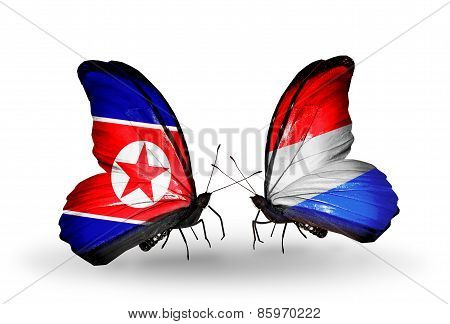 Two Butterflies With Flags On Wings As Symbol Of Relations North Korea And  Luxembourg