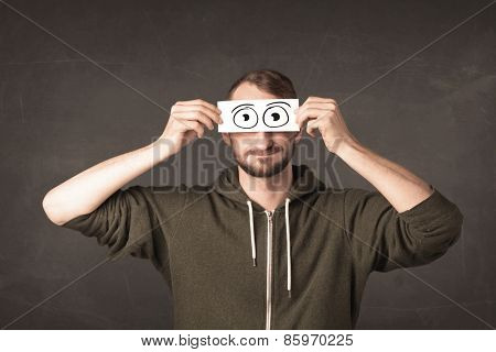 Funny man looking with hand drawn paper eyes concept