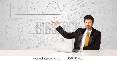 Business man sitting at white table with hand drawn calculations background