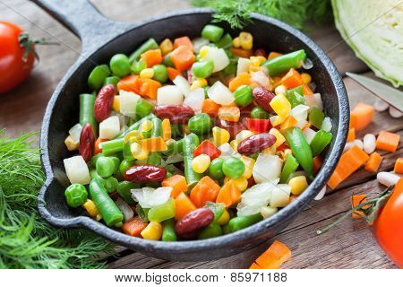 Mixed Vegetables In Retro Frying Pan And Ingredients On Wooden Rustic Table.