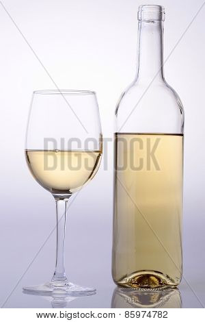 Wine Bottle And Glass With White Wine