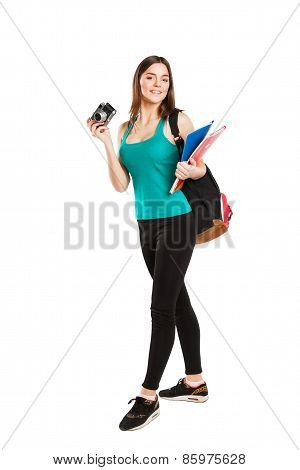 Beautiful young teenager student posing with notebooks and camera