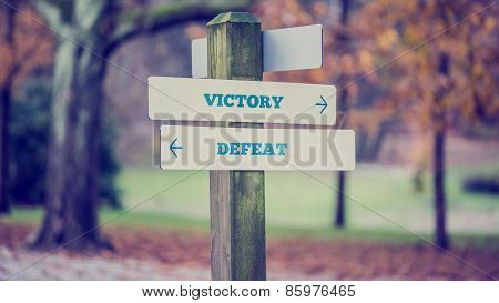 Arrows Pointing Two Opposite Directions Towards Victory And Defeat