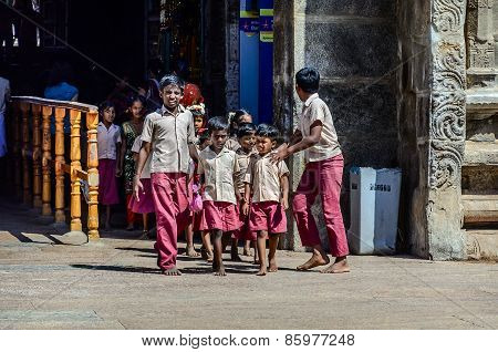 Indian school children in uniform go to excursion