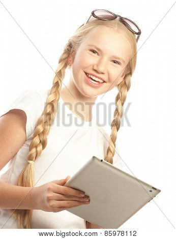 Pretty little girl with a Tablet PC. Isolated on white.