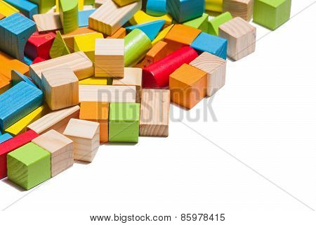 Wooden Blocks Lying In Line Isolated Over White Background