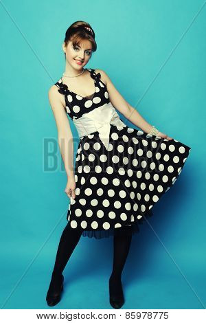 Young happy pin-up woman, glamour lady, studio shot