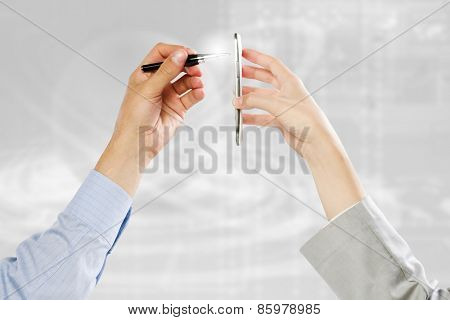 Close up of people hands using mobile phone