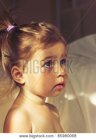 Toned portrait of Little cute girl is afraid