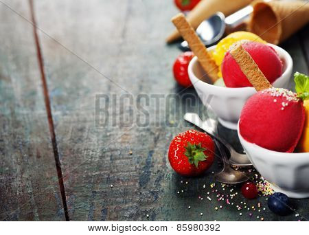 Two Ice cream scoops in bowls with wafer on wooden vintage background