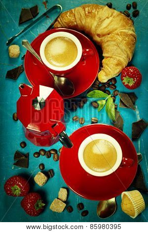 Breakfast with coffee, croissants and berries. Blue background