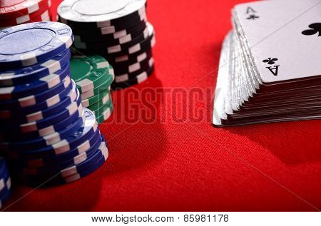 Stack of chips and cards. Poker. Blackjack. Roulette.