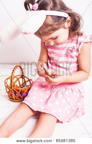Girl eats a chocolate eggs