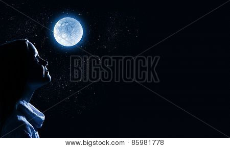 Cute girl of school age against night background