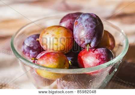 Plums in bowl.