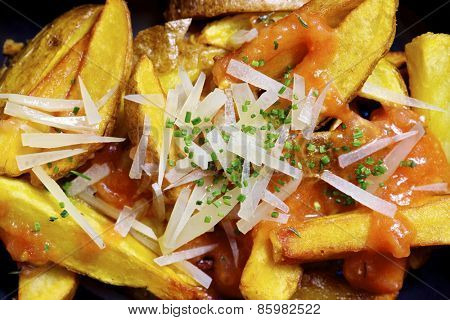 Closeup of some fries with vegetables.