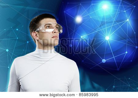 Young man in white against blue background with hologram around head