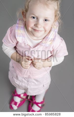 Portrait Of Young Caucasian Little Girl Trying On Mother's Shoes