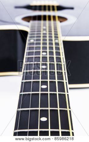 Close Up Of Acoustic Guitar Strings. Instrument Lying On A White Background