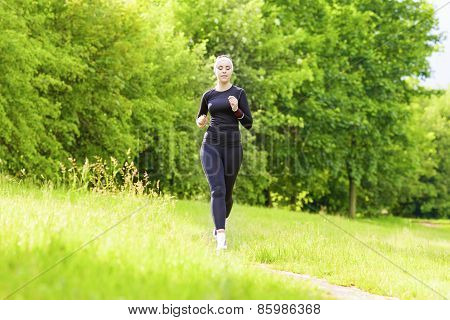 Jogging Concept: Caucasian Fit Woman Having Her Jogging Training Outside In Forest