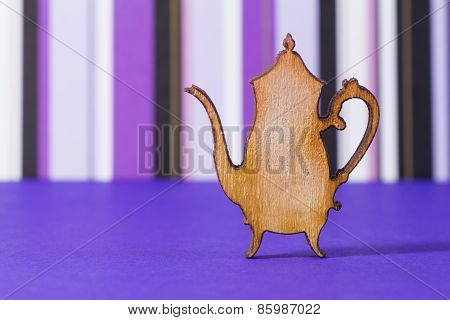 Wooden Icon Of Teapot On Purple Striped Background