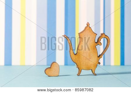 Wooden Icon Of Teapot With Little Heart On Blue Striped Background