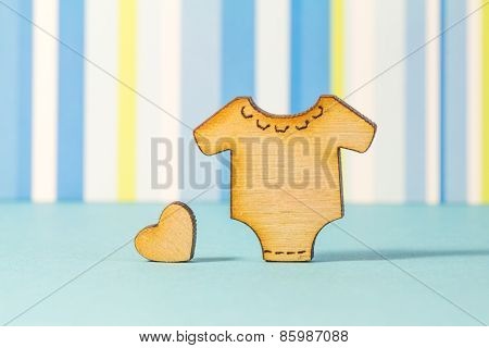 Wooden Icon Of Baby Bodysuit With Little Heart On Blue Striped Background