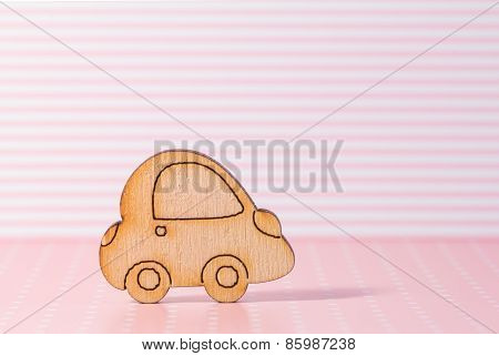Wooden Car Icon On Pink Striped Background