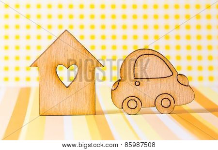 Wooden House With Hole In The Form Of Heart With Car Icon On Yellow Background
