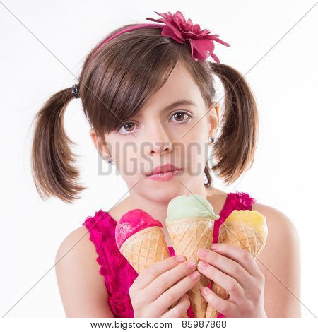 Little cute girl with ice cream over white background