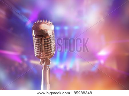 Retro microphone against colorful background