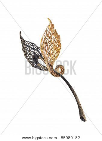 golden brooch with black and yellow diamonds