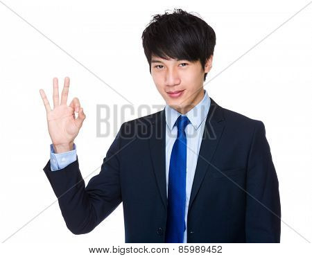 Ok hand sign gesture from asian businessman