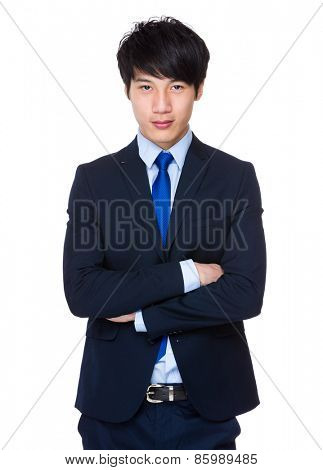 Handsome young asian man standing wearing a suit