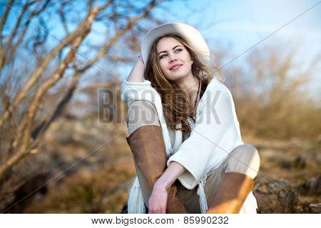 Beautiful smiling woman relaxing outdoors