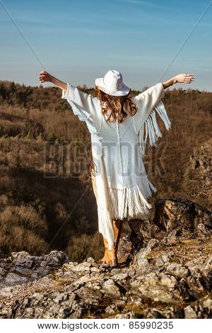 Woman enjoying the feeling of freedom walking in the mountains