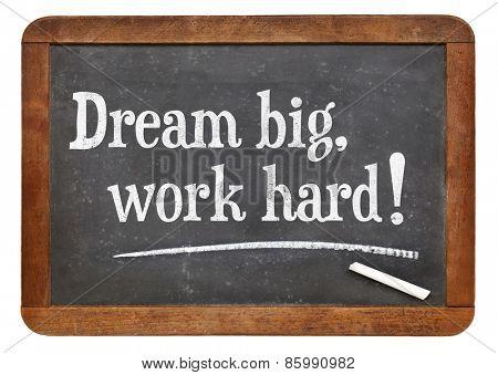 Dream big, work hard! Motivational words on a vintage slate blackboard