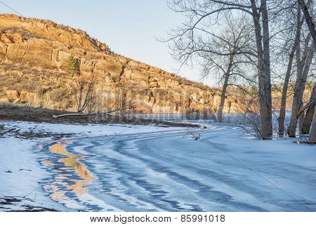 sandstone cliff and frozen lake - Horsetooth Reservoir in Fort Collins, Colorado