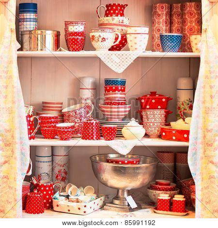 Red tea sets cups on the shelves