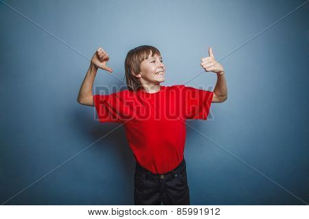 Boy, teenager, twelve years in the red shirt showing sign of Yes