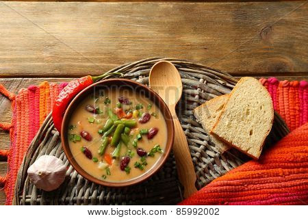 Bean soup in bowl on wooden table background