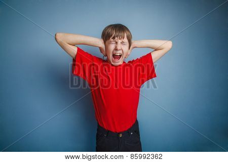 The boy, a teenager in  red shirt, closed his eyes and covered