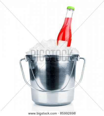Bottle with tasty drink in metal bucket isolated on white