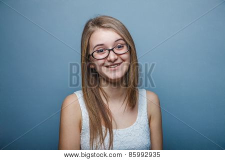Woman with glasses in white dress ,  looking straight and smiling