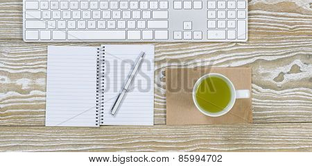 Office Desktop With Green Tea Drink