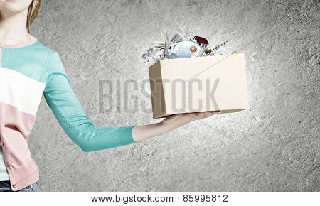 Close up of woman hand holding carton box