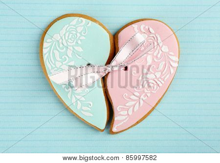 Heart shaped cookie for valentines day on color background