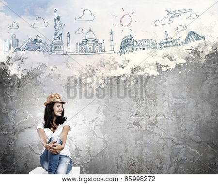 Young pretty lady dreaming about around the world trip