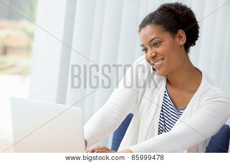 Businesswoman using her mobile in offfice