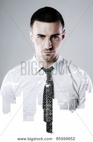 Double exposure of a businessman and city over gray background